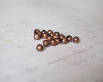 25 4mm copper colored metal beads