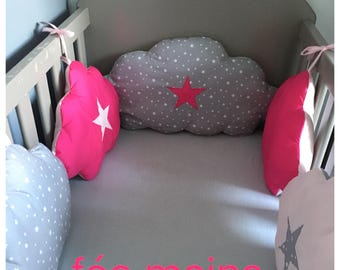 Baby bumper in the shape of pink and gray clouds with stars