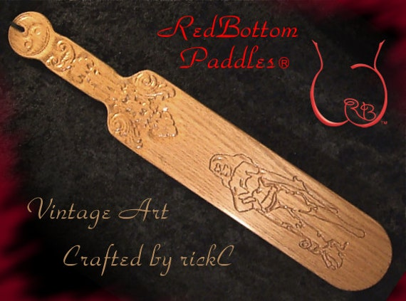 Paddle with vintage art engraved on front, handle carved both sides. INCLUDED: Black leather look pouch offering protection.