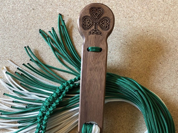 Celtic Design on the beautiful Walnut Handle Flogger.