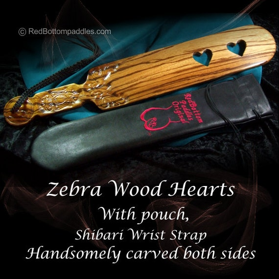 Exotic wood Line, carved Zebra Wood and cut through hearts. INCLUDES: Leather look pouch & Shibari wrist strap.