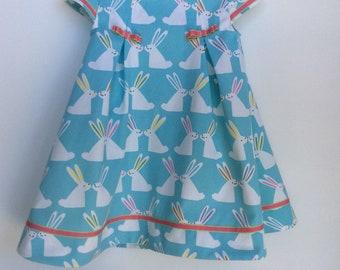 Easter dress. Cute bunnies on aqua blue background.