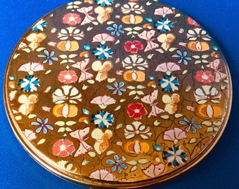 1950s Floral Garden Circular Powder Compact with gauze and mirror featuring Enameled fruits and flowers and butterflies