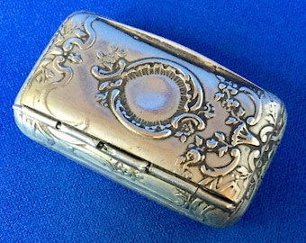 Victorian Unmarked White Metal or Silver Art Nouveau Snuff Box with Ornate Raised Design including a central area for a monogram