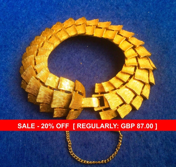 Articulated Gold tone Corocraft Bracelet