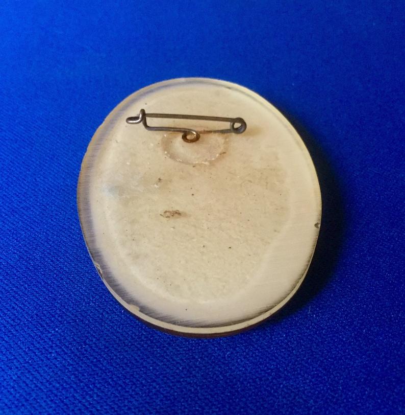 Unusual Round Plastic Lady Brooch  1930s