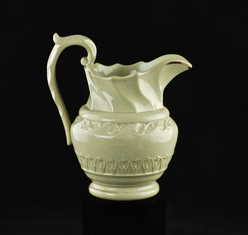 Antique Art Nouveau Ceramic Pitcher with Molded Body and Scalloped Neck and Handle