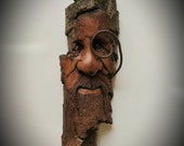 Wood carving of a wood spirit with a gnome home in his beard by Murray Watson hand carved tree spirit driftwood art wooden face ooak wood.