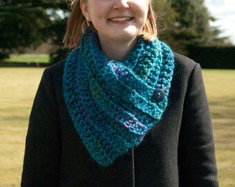 Hand crocheted buttoned cowl, super chunky mid blue flecked with pink and green, wool acrylic mix, with hand-stitched button