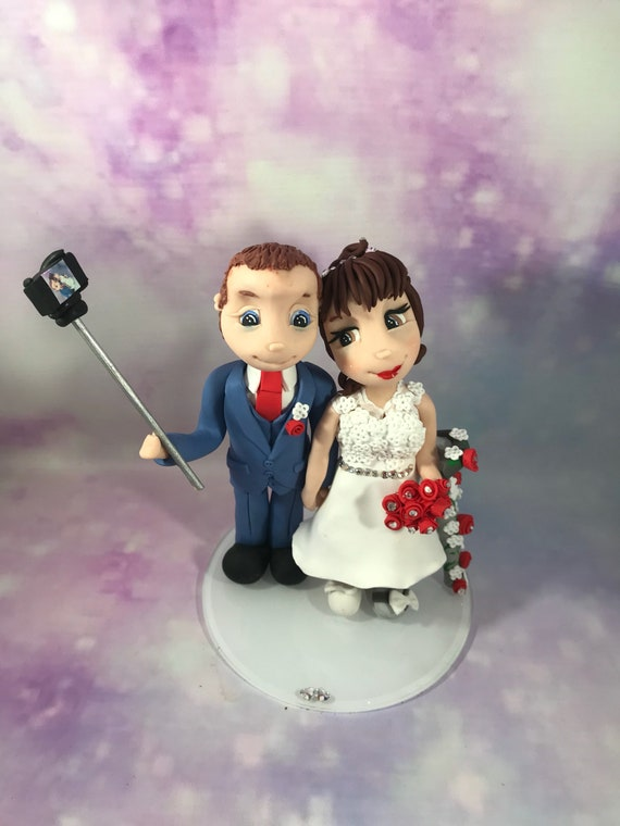 Fully personalised clay Wedding anniversary Cake Topper/keepsake - bride and groom with selfie stick.