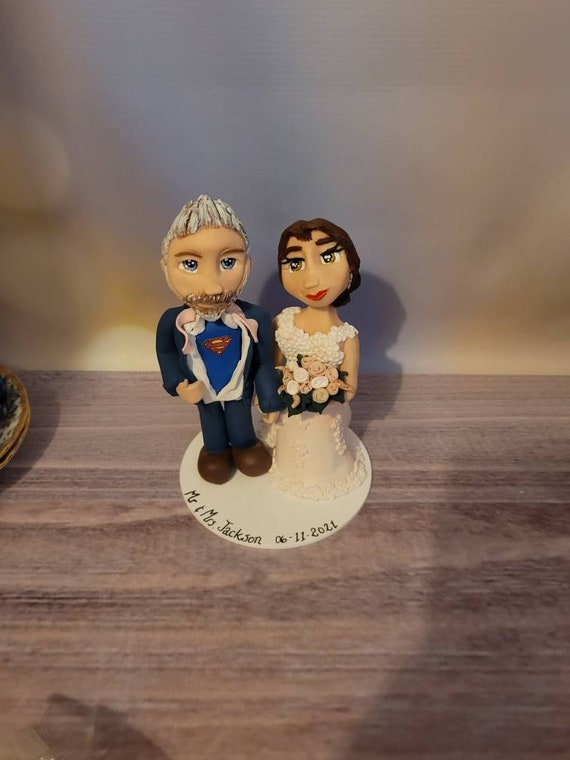 Personalised Wedding Cake Topper - figurines bride and groom/Same Sex Couple - Groom tearing open shirt / Superman Symbol.