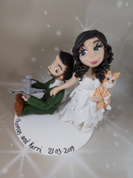 Custom Wedding Cake Topper - bride dragging Groom