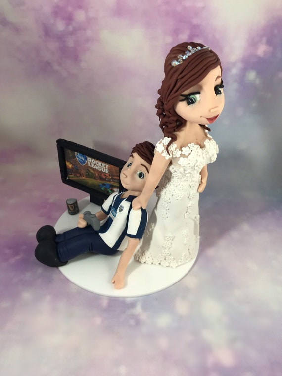 "Fully personalised clay Wedding Cake Topper highly detailed - Keepsake bride dragging groom away from ps4/xbox - 7"" cake and bigger"