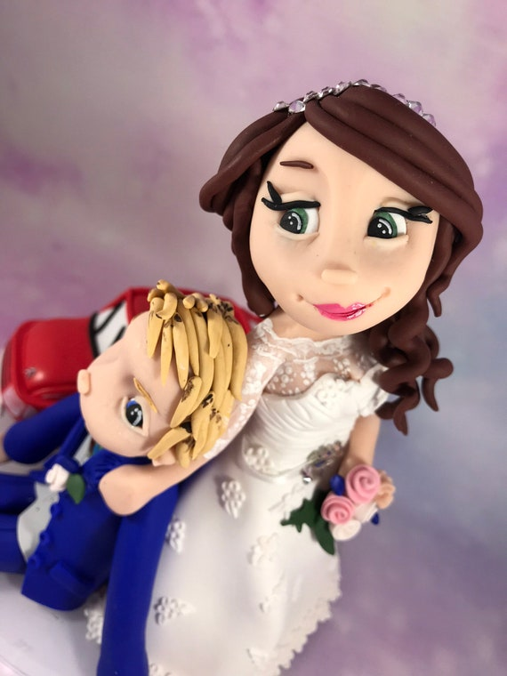 Personalised wedding cake topper -  Bride dragging groom