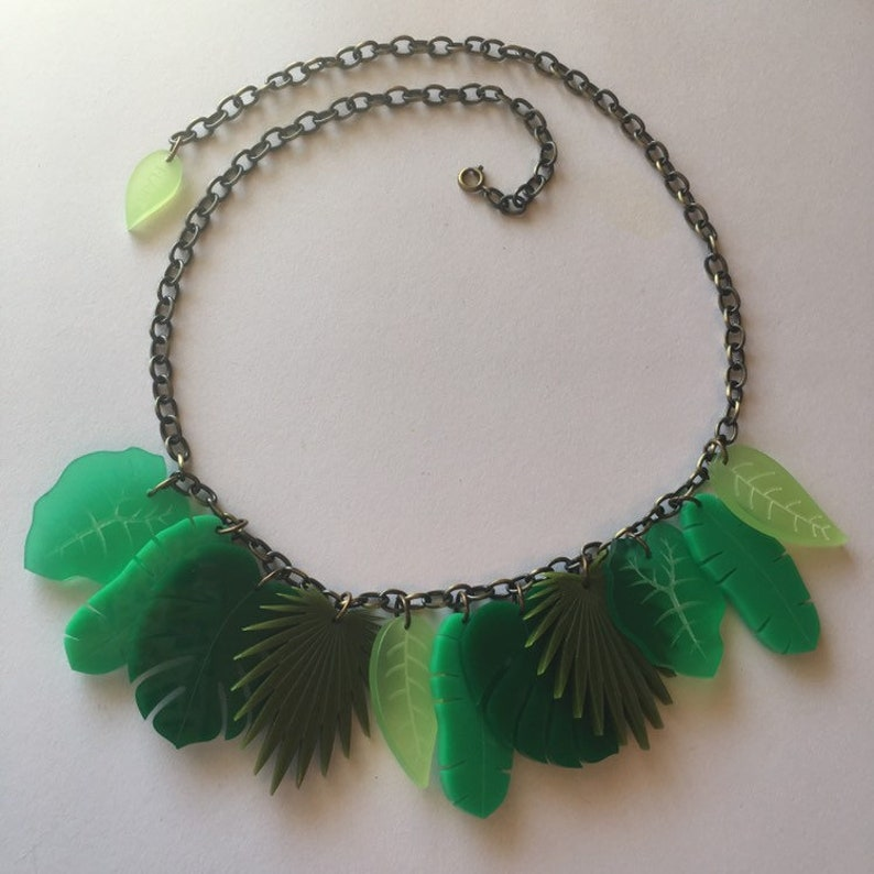 Vintage Style Jewelry, Retro Jewelry Flare Tropical Leaf Necklace $32.00 AT vintagedancer.com