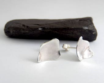 Silver stud earrings, abstract design