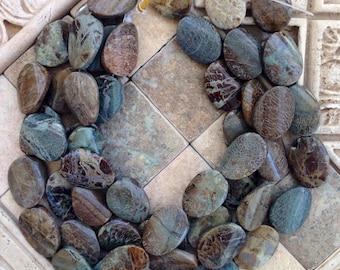 Reduced oval snakesin jasper beads