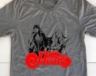afdb4fd5b042 Heart Band. Printed on heather Gray Unisex Crew neck T-Shirts. Celebrating  the awesome female Rockers!