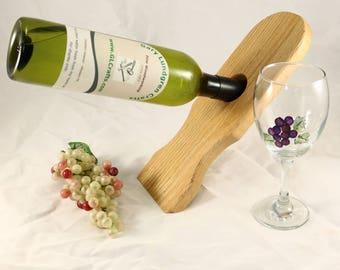 Bottle Balancer in Geometric shape made of Red Oak