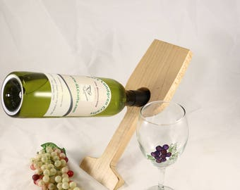Bottle Balancer in Wine Glass shape made of Maple finished in a clear lacquer
