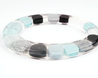 Slim bangle, translucent, opaque dots, blue, black, silverglitter, fits M