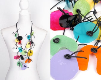 PUZZLE necklace No.3, three strands, multicolor, resin elements on rubber cord