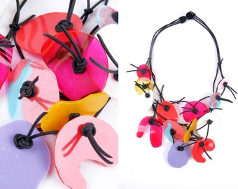 PUZZLE necklace No.4 ,short length, three strands, multicolor, resin elements on rubber cord