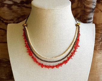 Coral and bronze necklace.