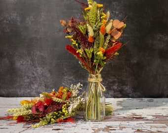 Dried Flower Arrangement for wedding, restaurant, home. Table decorations of dried flowers in autumn colours made into a mini milk bottle.