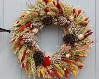 Festive Dried Flower Ready-To-Go Wreath. One time offer, rustic and seasonal ready to ship wreath from Florence and Flowers.