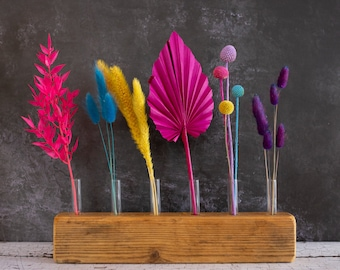 Dried Flower Display Piece with Vibrant Dried Flower Stems. For gifts and home décor, wooden block with test tubes and colourful flowers.