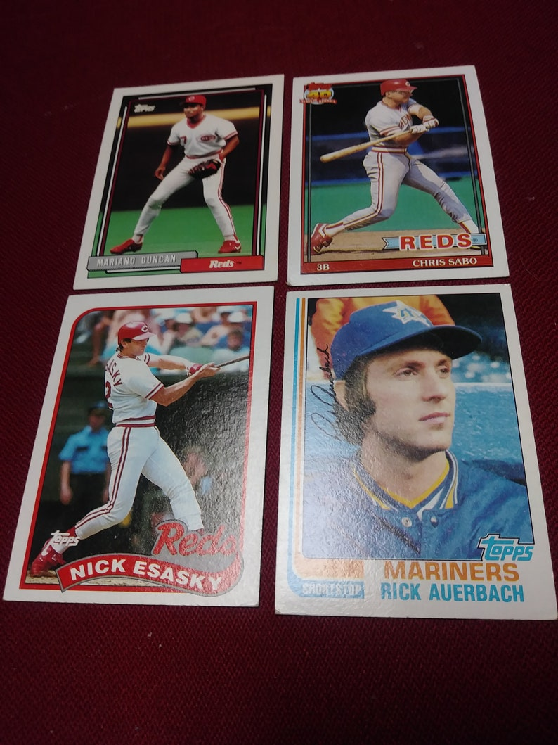 Four Topps Baseball Cards From The 80s 90s