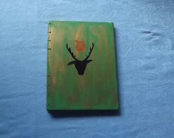 Coptic Stitch Journal - A5 - Horned God Painted Cover - Green and Black - Cream Pages