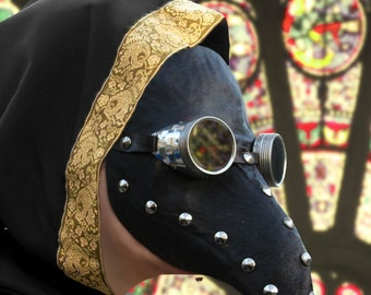 Plague doctor mask in black leather whit googles and stud dark steampunk cosplay larp burning man fantasy venice gothic
