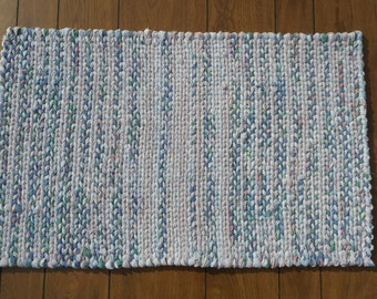 Rectangular twined rag rug in pink, white, blue and green
