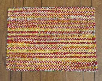 Red, bright yellow and cream twined rag rug