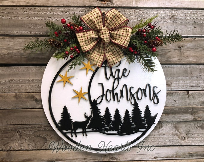 "Christmas Sign for Front Door PERSONALIZED Holiday Hanger Wreath Wood Round Moon Deer Trees Greenery Berries, 16"" 3D Wood Lettering Xmas Bow"