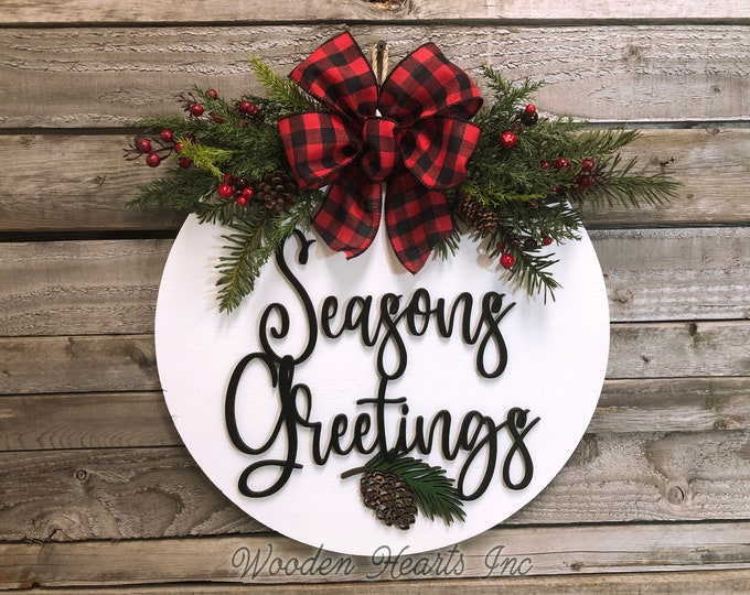 "Seasons Greetings Holiday Door hanger Wreath Wood Round Pinecone Sign Greenery, Happy Holidays, Merry Christmas, 16"" 3D Wood Lettering Bow"