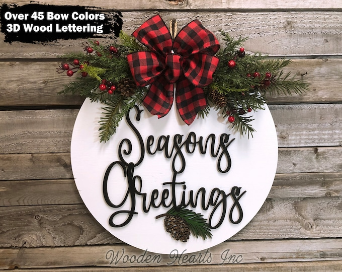 """Seasons Greetings Holiday Door Hanger, Wreath Wood 16"""" Round Pinecone Sign + Greenery, Happy Holidays, Merry Christmas, 3D Wood Letters +Bow"""