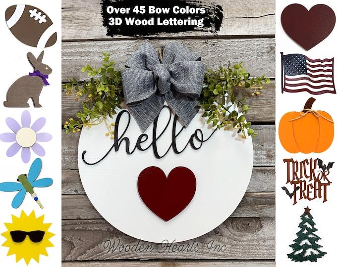 """HELLO Wreath Signs Door Hanger Welcome with Bow Front Door Decor + Interchangeable Season Changer Piece 14"""" Round,  Spring Heart"""