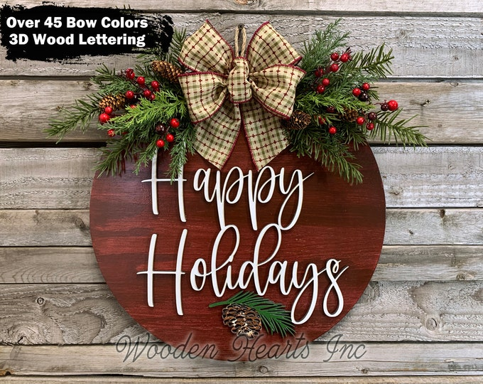 """Happy Holidays Door Hanger Wreath, 16"""" Wood Round Pinecone Sign + Greenery, Merry Christmas, Seasons Greetings, 3D Wood Lettering, Xmas Gift"""