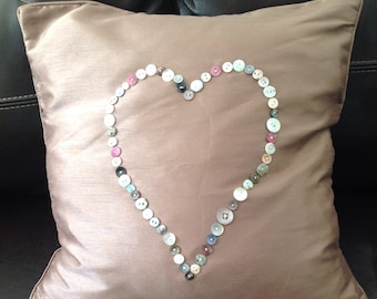 Handcrafted cushion cover with sea shell heart. Mink.