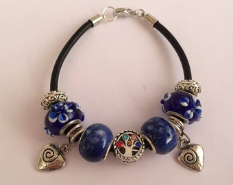 Blue charm's bracelet with tree of life and ref 636 heart charms