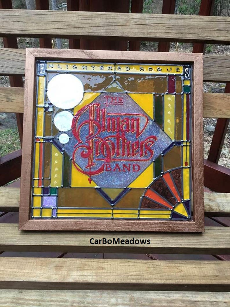 Faux Stained Glass Enlightened Rogues album cover image 0