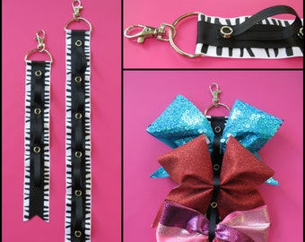 Cheer bow holder for backpacks and cheer bags, cheer bows, bow organizer, cheerleading bows, cheerleading accessories, cheer bow display