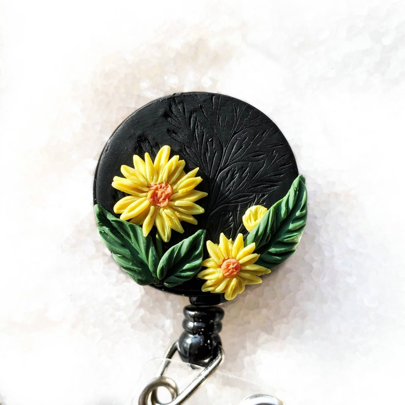 Yellow flowers badge reel