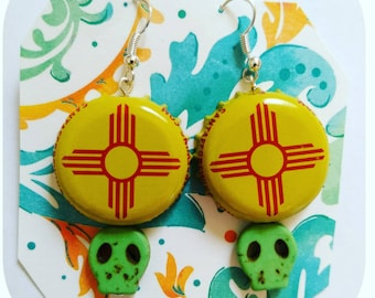 Zia symbol upcycled bottle cap earrings with green calaverita beads.