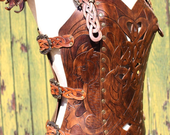 Leather armor corset and bracers! Viking celtic owl cut-out design in heavy duty leather. Buy together and SAVE! Now in two-tone Dark Brown!