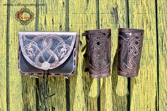 "Leather bracers AND pouch, Viking- ""Floki"" celtic dragon cut-out design. Buy the HALF length bracers and pouch together and get a DISCOUNT!"