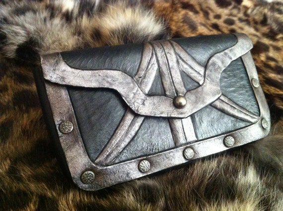 The Assassin- tooled leather case...for when you prefer phone, ID and cash be carried on a belt next to your dagger.